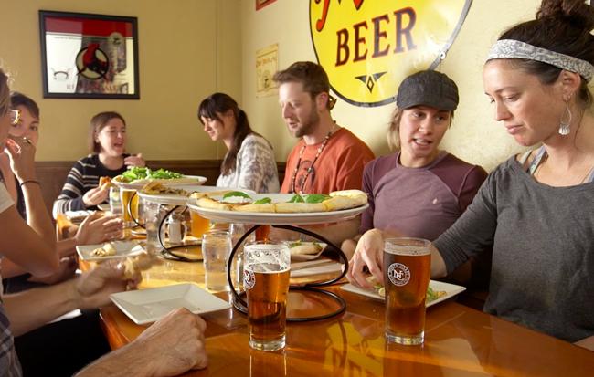People enjoying meal at North Coast Brewing Company